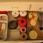 Pantry Drawer Using Vintage Trays for Organization.