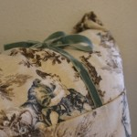 Toile used as a pillow slipcover with wonderfule sage silver velvet ribbon.
