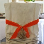 Simple vintage grain sack as a chair slipcover.