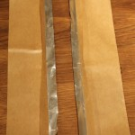 Step 2: Fold back adhesive paper, lengthwise, about a half inch.