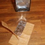 Step 10: Peel off paper tape on back of foil, exposing the adhesive.