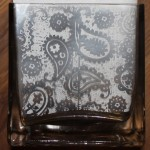 Step 13: Once the tape has been burnished, pull away from glass.  The embossed image will remain.