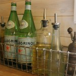 Vintage Bottles used for cooking find a home in a reproduction basket.