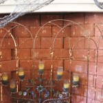 Old Wire Garden Fencing as a screen for a faux fireplace.