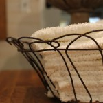 Vintage Wire Basket holding dish towels.