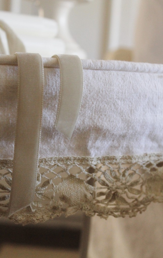 Piping detail and vintage lace make this slipcover very special.