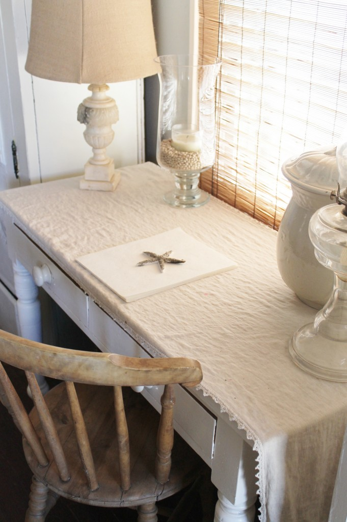 Old linen runner that is a family heirloom along with an antique alabaster lamp.