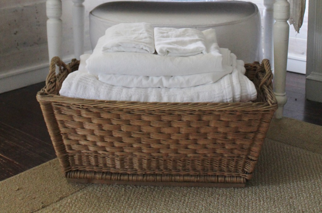 Fresh, white and clean sheets with lavender scent in the vintage French Laundry Basekt