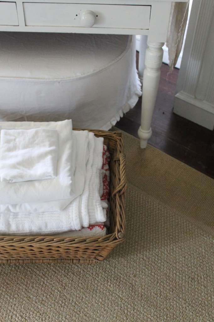 Freshly dried and folded linens in the French Laundry Basket.