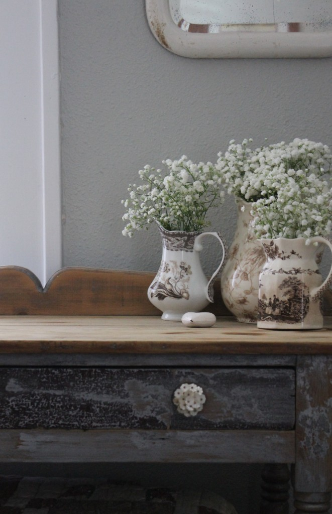 Baby's Breath in antique vessels.