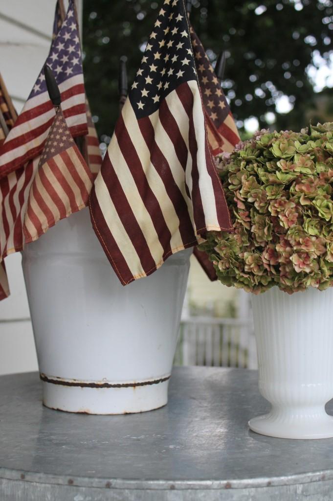 A vintage enamel bucket next to my garden hydrangeas in a milk glass vase.  Classic combo.