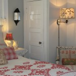An old quilt, pillows made from vintage fabric and a ambient lighting make this one cozy bedroom.