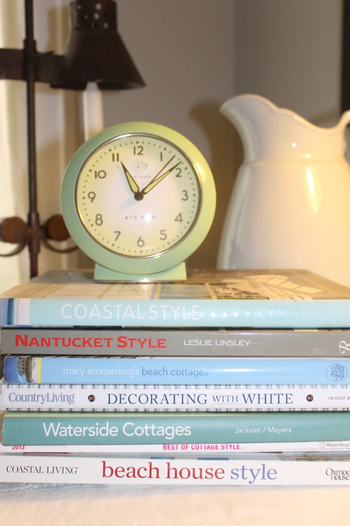 A reproduction vintage alarm clock perched on my coastal design books make for great bedside reading!