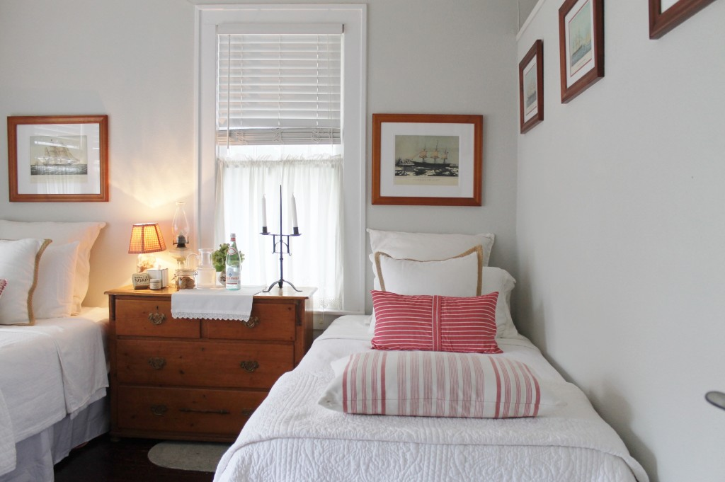 A mostly soothing, white room, I can't resist well placed doses of my favorite color, red.