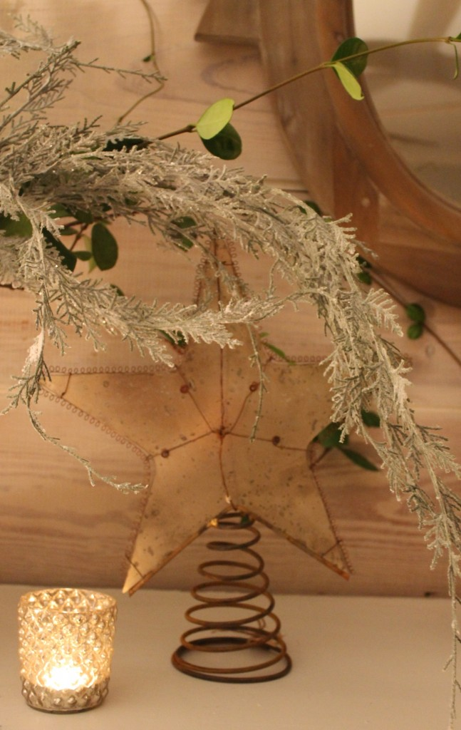 Distressed mirror star tree topper offers a vintage touch.