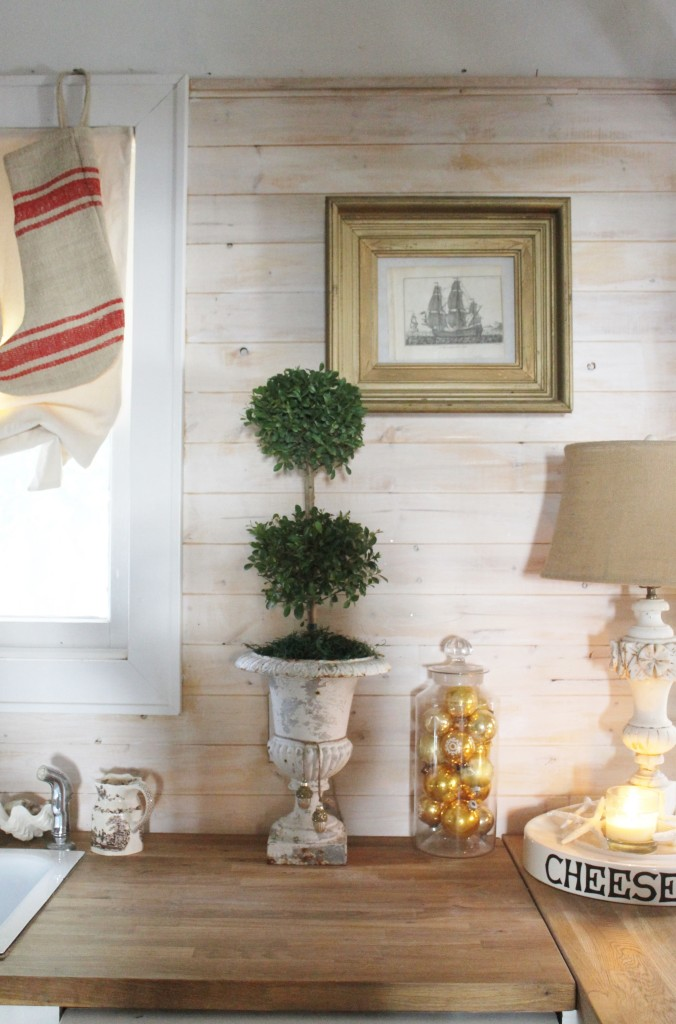 A lovely Eugenia topiary from Walmart ($11.98) in an antique urn.
