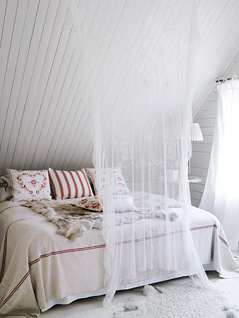 Nordic Bliss - a bed cozily tucked under the eaves.