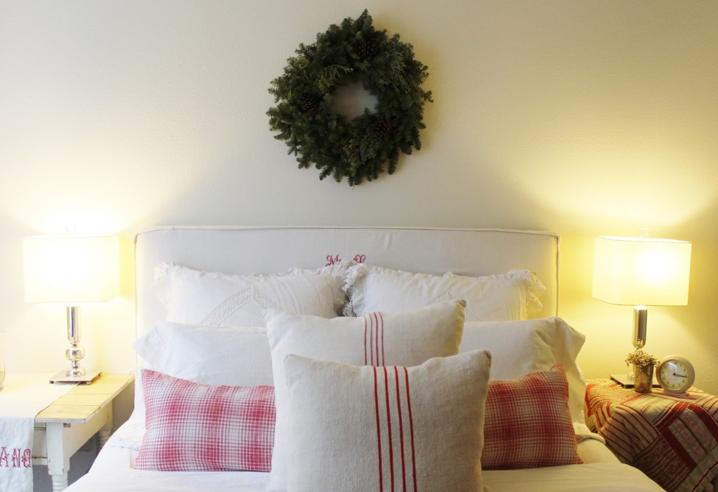 Keeping it simple with a wreath hung above the bed.