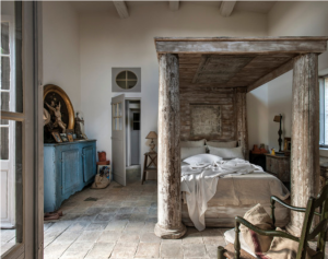 Beautiful French farm house bedroom.  I love the stone floors and the architectural salvage bed.  But mostly, my eye was drawn to the window above the door.