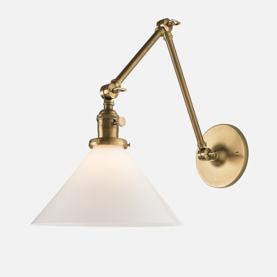 Adjustable arm wall sconce in antique brass finish.