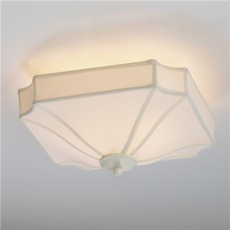 Ceiling fixture with simple silk shade.