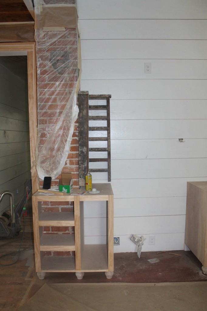 Kitchen cabinets built around an original feature of the house, the brick chimney