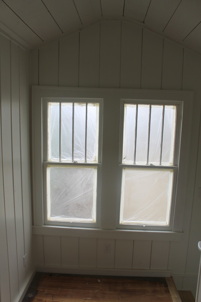 Windows that were in another part of the house, reset in the upstairs sitting area