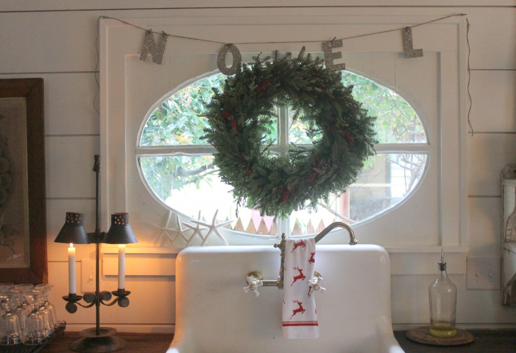 The use of NOEL is apropos of the French farmhouse window above the kitchen sink.