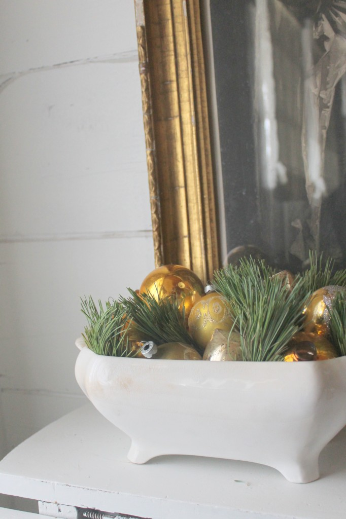 Sprigs of fresh greens, vintage glass ornaments in a simple ironstone bowl.