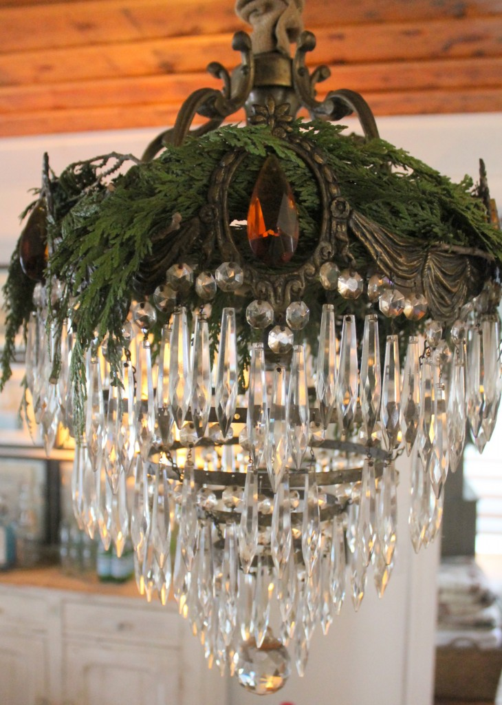 My antique chandelier with a crown of fresh Christmas greens.