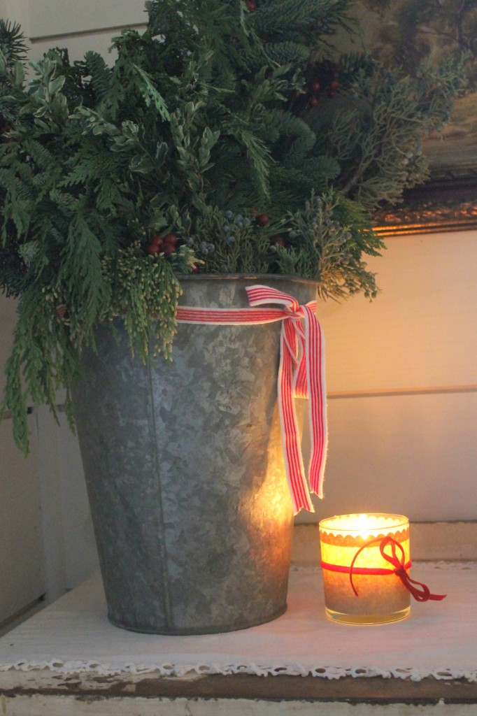 An old sap bucket is a terrific alternative to more expensive vessels to house a holiday arrangement.