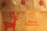 A simple lunch sack folded over, left plain or using holiday stamps and embellishments as I have done.