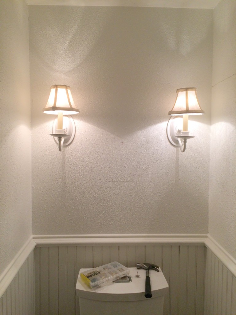 Downstairs bathroom - Before. Sconces that weren't in the budget to replace, needed some updating. The shades were full of debris from the renovation and really couldn't be salvaged.