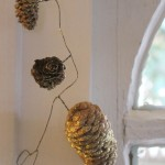 Sparkly pine cones on some wire for a festive garland.