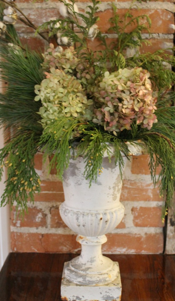 Dried hydrangeas with fresh greens make a lovely arrangement.
